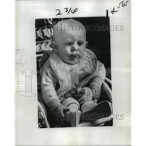 1977 Press Photo Child in Seat Wearing Bib - noa23035