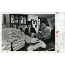 1989 Press Photo Workers checking raw silk at Silk for Life in Milwaukee