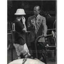 1965 Press Photo Prince Philip coaches son, Prince Charles between polo game.