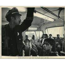 1984 Press Photo keeping an eye on passengers is Sheriff's Deputy Henry Green