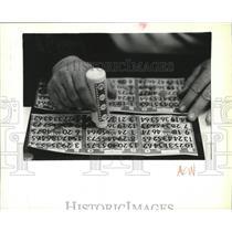 1989 Press Photo Gambling-Bingo player keeps track of his six cards - spa62171
