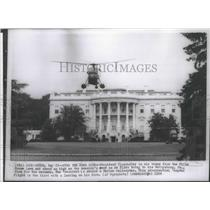 1958 Press Photo President Eisenhower is air borne from the White House lawn