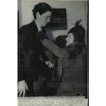 1937 Press Photo Myllicent Bartholomew straightens Freddie Bartholomew's tie