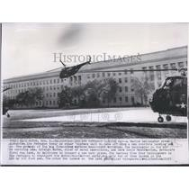 1955 Press Photo Marine helicopter rises alongside the Pentagon - spw11601
