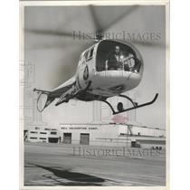 1959 Press Photo Robert A. Roth pilots First Wisconsin National bank helicopter