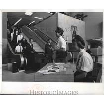 1966 Press Photo Travelers at Mitchell Field greeted by Norgal and Kocourek