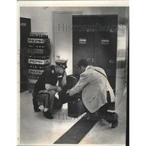 1972 Press Photo Officials inspected locker for bomb at General Mitchell Field.