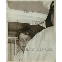 """1961 Press Photo Alabama-Segregation, """"Freedom Riders""""- person held with police."""