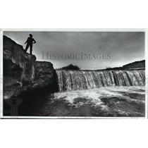1983 Press Photo A man stands by a waterfall about 2 miles south of Rock Lake