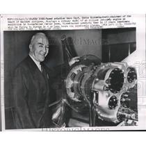 1958 Press Photo Captain Eddie Rickenbacker with jet-prop engine model, New York