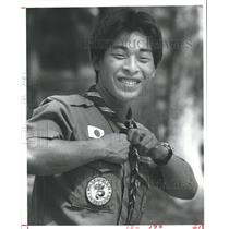 1982 Press Photo Boy Scout from Japan at Camp Strake Straightens Neckerchief