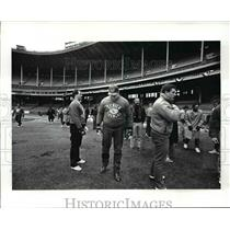 1987 Press Photo Denver Bronco players survey the Cleveland Stadium field.