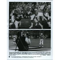 1989 Press Photo John Elway leads Denver Broncos against the Buffalo Bills.