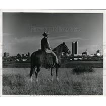 1980 Press Photo Open range and modern metropolis share landscape. - cvb26180