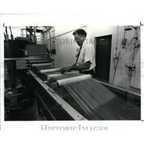 1987 Press Photo James F. McCray Sr. seen checking a Spaghetti Resin machine