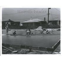 1964 Press Photo Paving Slab Clair Shore worker apts - RRV98369