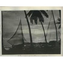 1930 Press Photo Fishing nets and native life and tropical sunset, Philippines