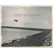 1940 Press Photo Dutch Military plane patrols the Zuider Zee Dyke, Holland.