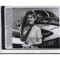 1964 Press Photo Pilot Joan Merriam holds Koala Bear doll before taking off