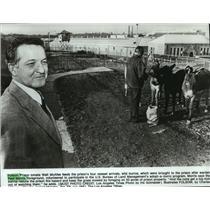Press Photo Paul Morris, Folsom Prison Warden joins the adopt-a-burro program