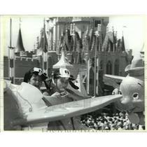 1987 Press Photo Two boys enjoy a ride on Dumbo in Walt Disney World - mja98975
