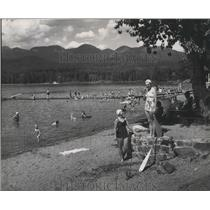 1959 Press Photo White Fish City Beach in Montana-vacationers enjoy the water
