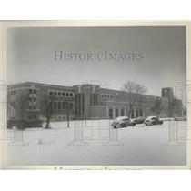 1954 Press Photo Building Covered in Snow in Kalispell, Montana - spa85246