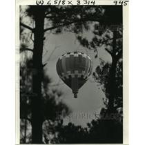 1980 Press Photo Hot Air Balloon Over Forest in Covington, Louisiana - noa25127
