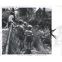 1967 Press Photo Kids Playing Near Drain - RRX97093