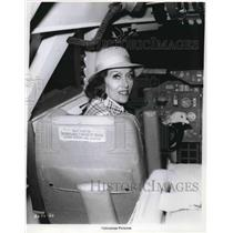 "1974 Press Photo Gloria Swanson in airplane cockpit to promote ""Airport '75""."