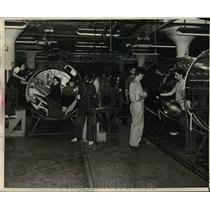 1942 Press Photo Workers at Plane Manufacturing plant - nem48592
