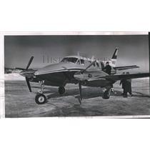 1965 Press Photo Kearney & Trecker official boarding a Beechcraft King Air, Wisc