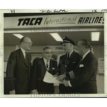1966 Press Photo Pilots and officials discussing flight plans first jet flight
