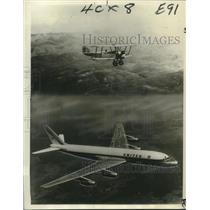 1966 Press Photo Douglas Dc-3 Airplane Flying in the Air with Biplane