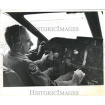 Press Photo Local Green Berets-a pilot shown on the flight deck - sba21821