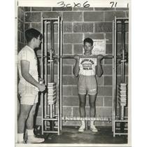 1966 Press Photo Wayne Doucet, blind sophomore at Fortier School, lifts weights