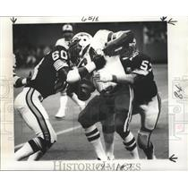 1977 Press Photo Football Player Jim Braxton Tackled by Saints Players at Game