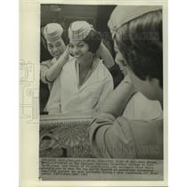 1963 Press Photo Sharon Henry shows stewardess Joan Dorsey how to wear cap