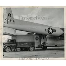1965 Press Photo Hurricane Betsy: Truck with Relief Supplies loads Airplane