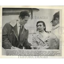 1961 Press Photo Delamarre, French stunt parachutist, bids farewell to his wife