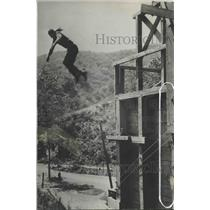 1934 Press Photo Fred Thomson, widely known stunters, is making dangerous leap.