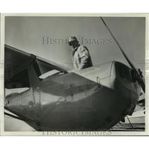 1957 Press Photo Clarence Schmidt with his Cessna 120 plane, Milwaukee