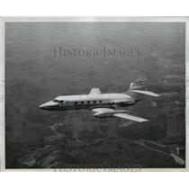 1959 Press Photo Lockheed Jet Star flies high the sky - nem51508