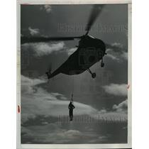 1952 Press Photo A flyer is downed by helicopter during a Fort Bragg Air Show