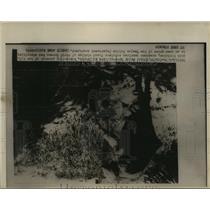 1930 Press Photo Genera John Church checks American victims at Taejon Open Grave