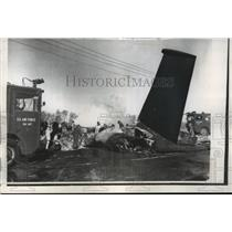 1961 Press Photo Offutt Firemen Probe Wreckage of Air Force Four-Jet Bomber