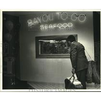 1987 Press Photo Jim Keriotis at the Grand opening of Bayou To Go Seafood