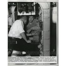1958 Press Photo Fenton Duepner Talks Operation of Space Cabin with Don Farrell