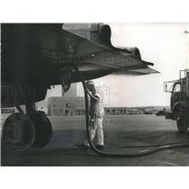 1965 Press Photo Worker Refuels Airplane at Birmingham, AL Municipal Airport