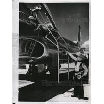 1955 Press Photo Little boys play around the jet plane at Clark Air Force Base